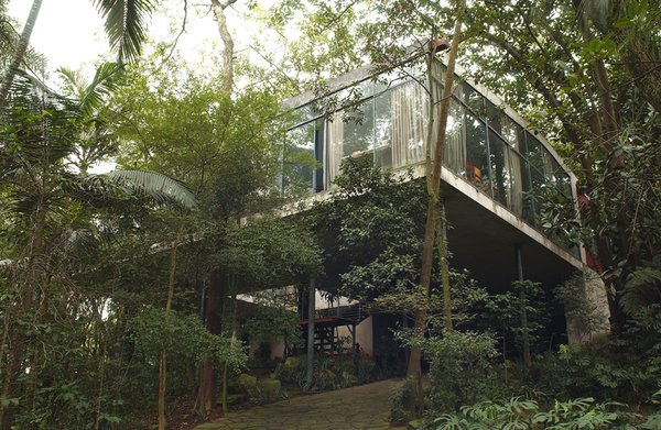The Glass House as it appears today, with the forest grown around it, as Bo Bardi had anticipated—she insisted that the displaced vegetation be replanted just after the house was finished. Photo courtesy Espasso.