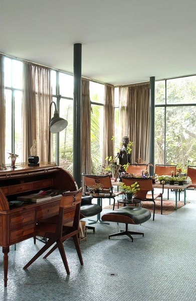 The living area of the Glass House held many of Bo Bardi's furniture designs, including the desk chair and dining chairs. Both shared the similar elements of corsetlike back stitching, a motif still replicated today. Photo courtesy Espasso.