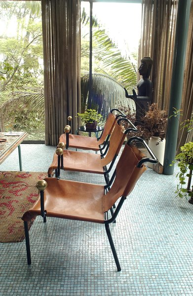 The leather sling and ball motif of the dining chairs were repeated in other Bo Bardi designs. Photo courtesy Espasso.
