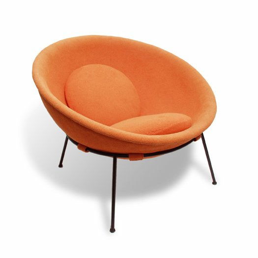 Bo Bardi's Bowl chair, designed in 1951 of iron and aluminum, with orange fabric.