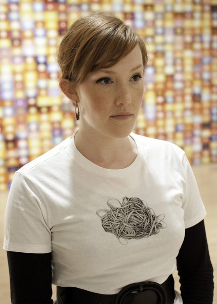 This shirt, which appears to show an unraveling ball of rubber bands is by artist Rosana Castrillo Díaz.