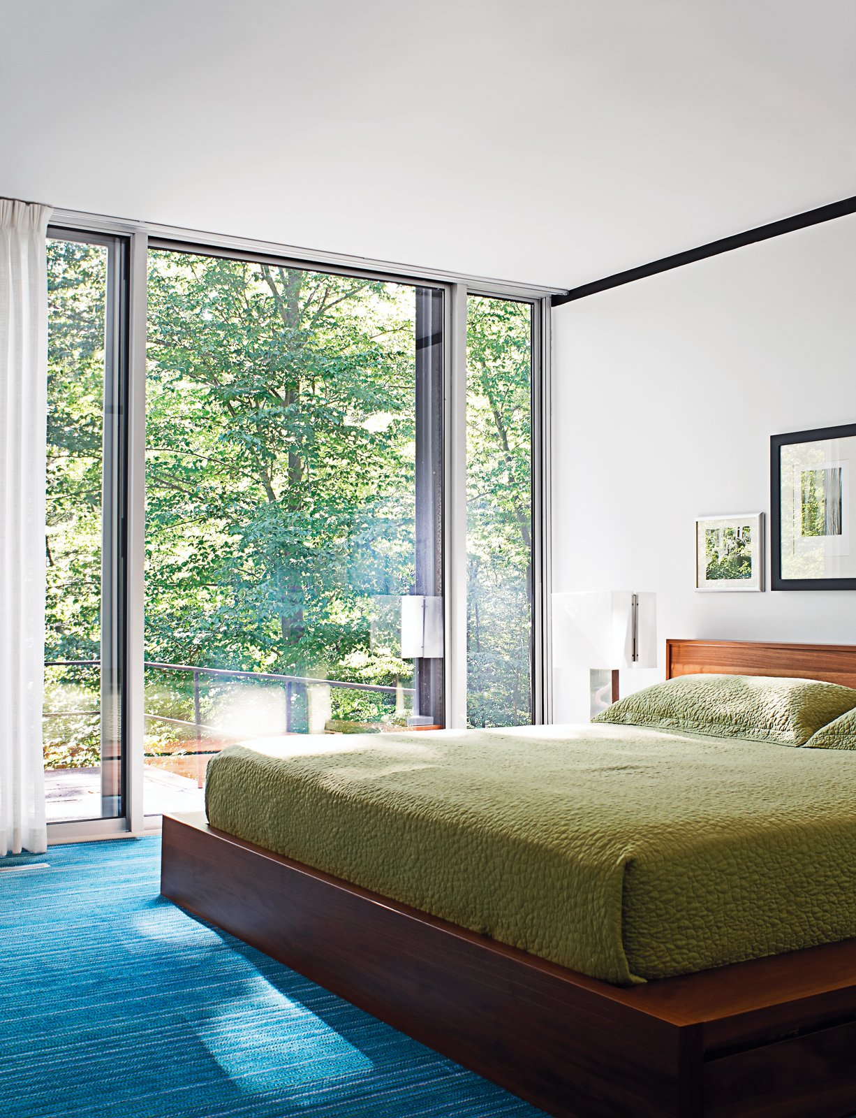 The master suite contains the only nonvintage furnishing: a BoConcept bed. Tagged: Bedroom, Bed, Carpet Floor, and Table Lighting.  Photo 7 of 17 in Mod Men
