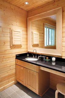 A discreet master bathroom eliminates visual clutter.
