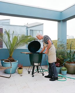 Michael tends to his capons in a Big Green Egg.
