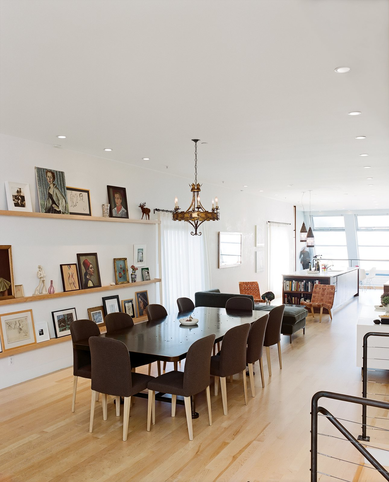 """Molteni dining chairs are overseen by """"someone's"""" ancestral portraits. Tagged: Dining Room, Chair, Table, Shelves, and Pendant Lighting.  Photo 6 of 14 in Project Runaway"""