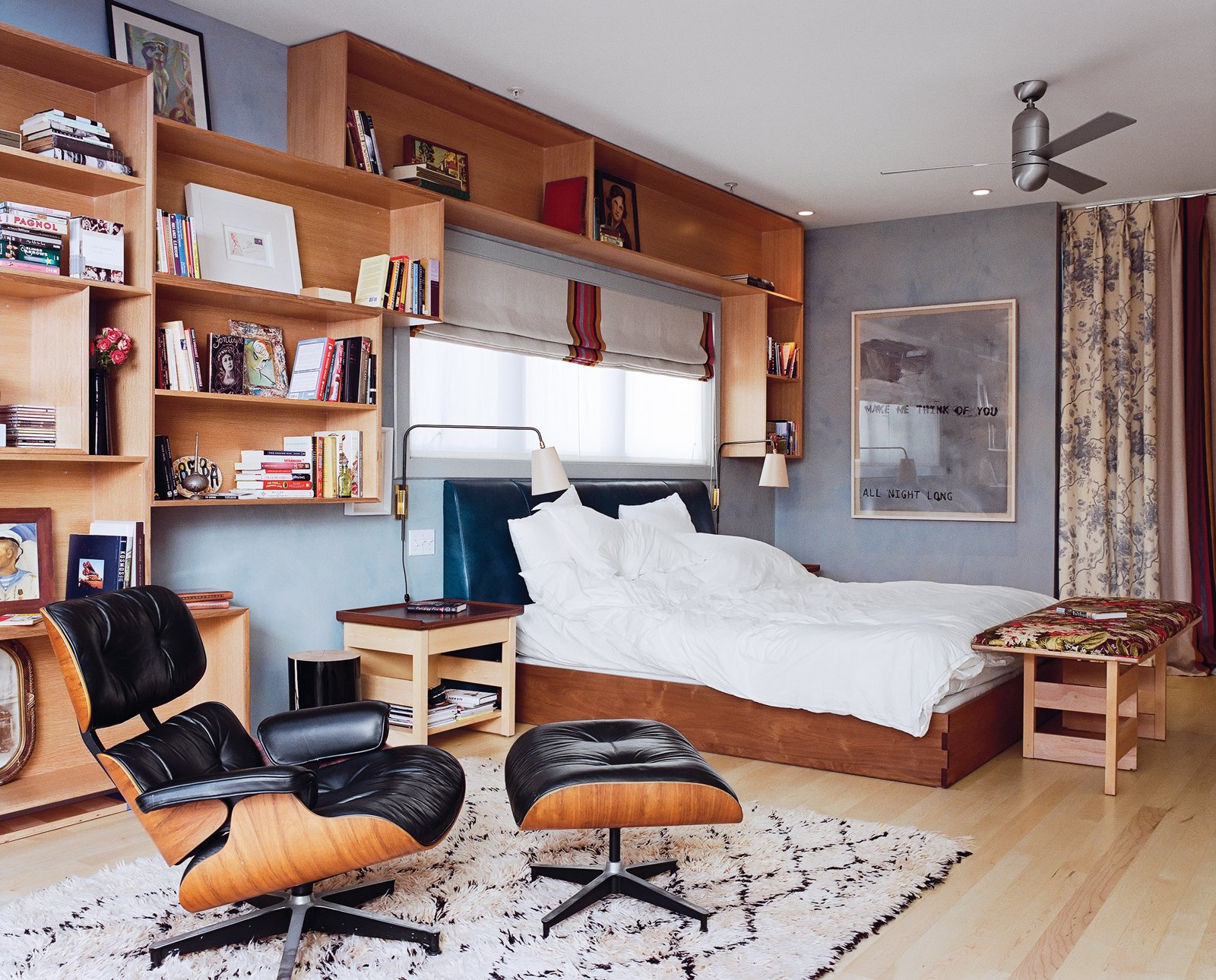 Bookcases abound in the master bedroom, which has a vintage Moroccan rug from John Derian and a painting by Ward Schumaker. The bench and bedside table are by Philip Agee. Tagged: Bedroom, Chair, Bed, and Light Hardwood Floor.  Photo 14 of 14 in Project Runaway