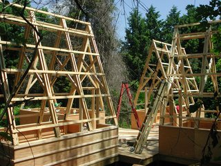 Swamp Thing - Photo 7 of 17 - The shape of the prefabricated trusses was inspired by sails and Moskow's father-in-law's love for boating. The collection of shelters is reminiscent of days past when groups of covered wagons traveled West.