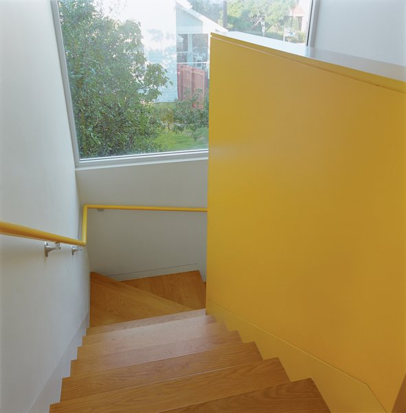 Bestor gave each area of the house its own color scheme. The bright yellow stairwell maintains a cheery mood throughout.