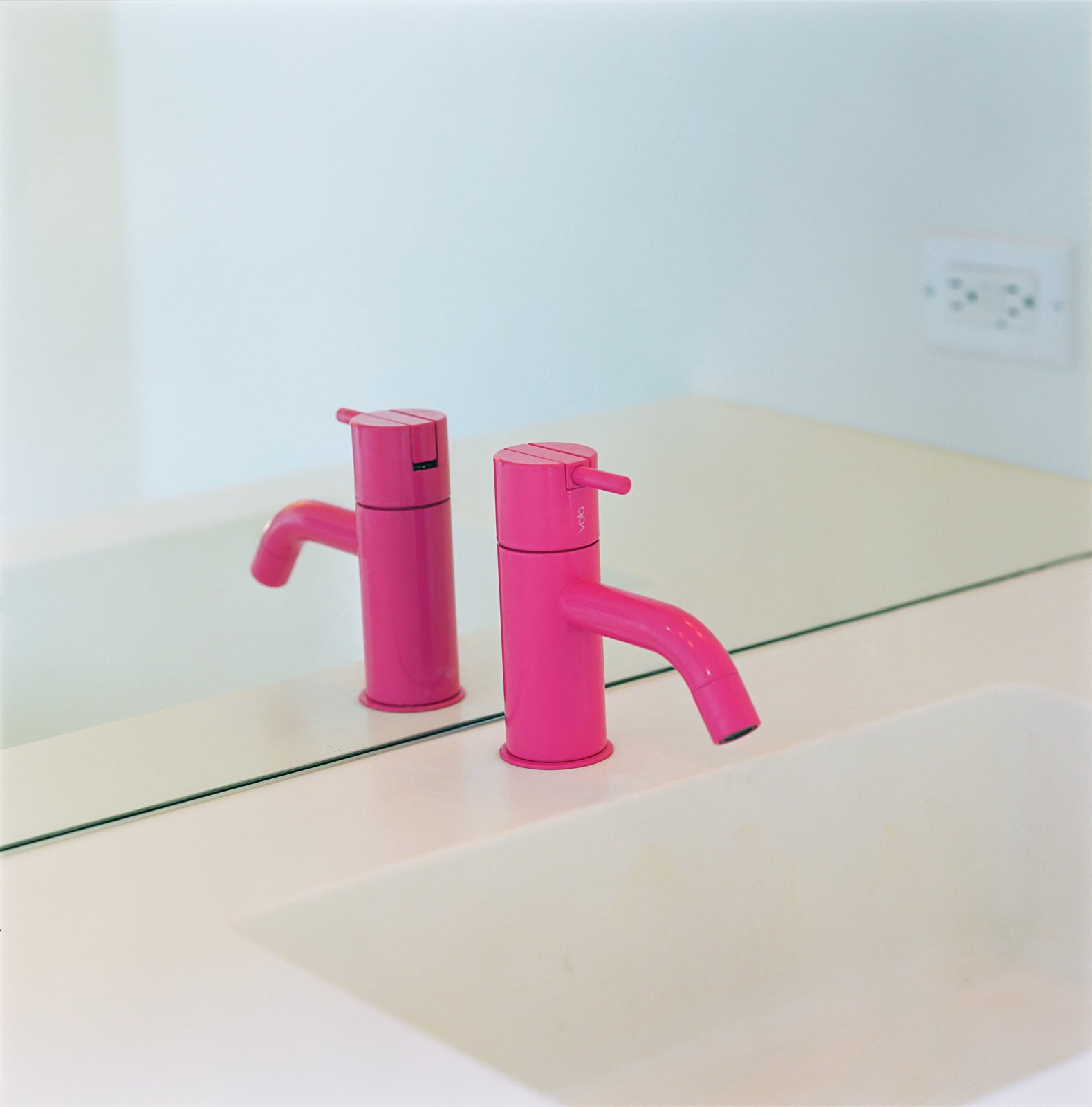Magenta is one of Grunbaum's favorite colors, so he picked out a magenta Tufty-Time couch by B&B Italia and added a hot pink powder-coated faucet by Vola for the downstairs bath.