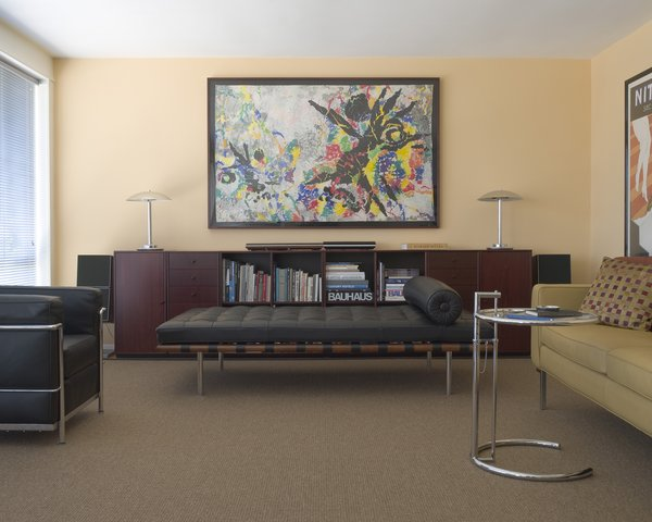 Here is a nice head-on shot of the living room with a Barcelona daybed by Mies, a Corbu chair, and an end table by Eileen Gray. Machines for living indeed. Photo by Mark Darley.