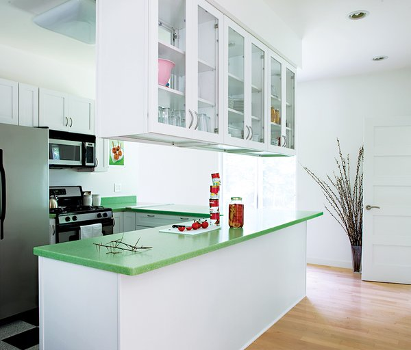 A leaf-green countertop adds a splash of color to the kitchen.