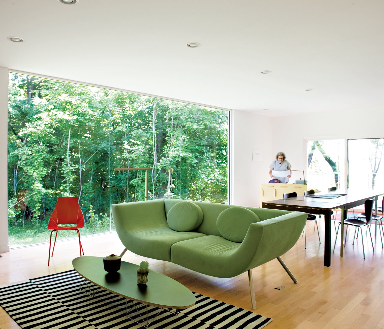 The living-room sofa is by the New York–based designer Stanley Jay Friedman. Tagged: Living Room, Chair, Sofa, Recessed Lighting, and Light Hardwood Floor.  Photo 2 of 10 in Bringing It All Back Home