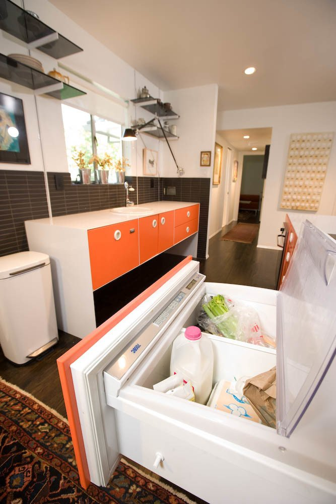 The designer eschewed expensive cabinetry in favor of powder-coated stainless steel, and found the Miele cooktop and oven at a floor sale. To keep things uncluttered, Popp installed a Sub-Zero under-counter refrigerator, a small Fisher & Paykel dishwasher and a simple Hansgrohe faucet, all found at a discount.  Photo 3 of 6 in Renovation: 800 Square Feet