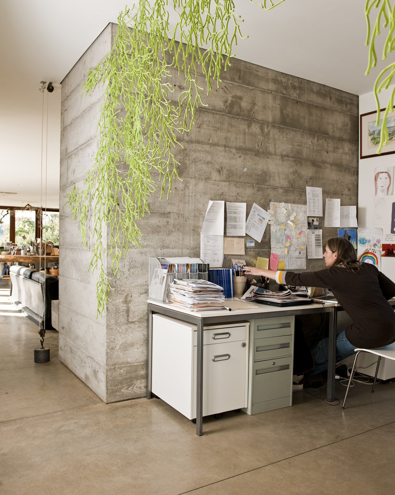 The open office space is partially secluded thanks to the hanging Algues by Ronan & Erwan Bouroullec for Vitra. Tagged: Office and Desk.  Photo 14 of 23 in Fertile Grounds