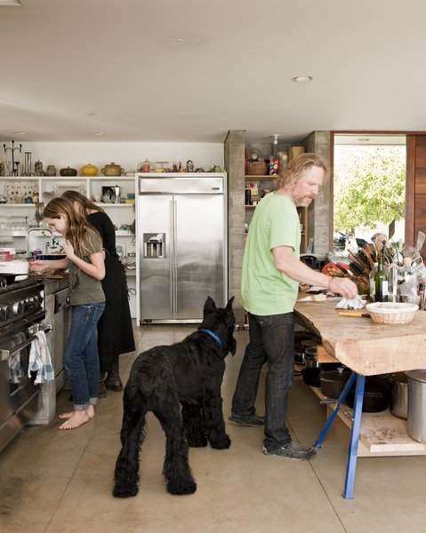 The family needed space not just for cooking, which they do a lot of, but for massive kitchen projects like making wine from their homegrown grapes and oil from their olive trees.