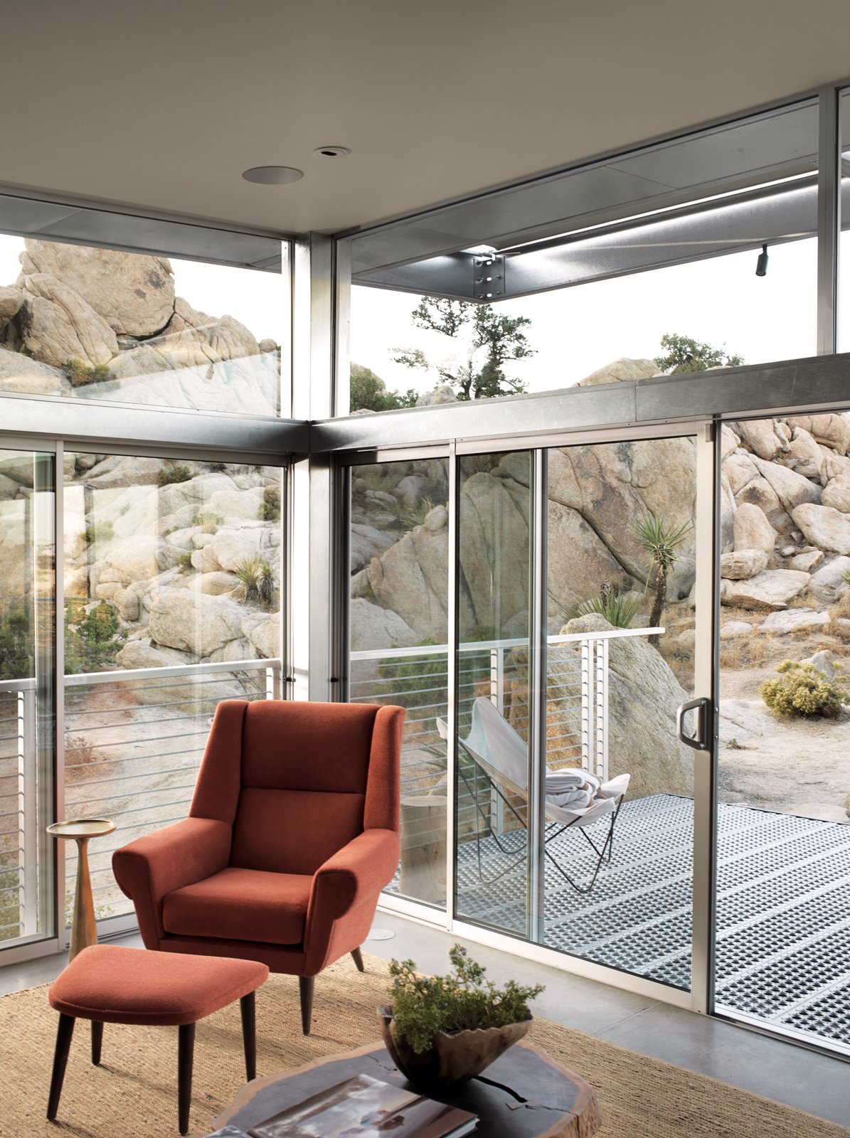"""The main living area extends to the deck through sliding glass doors.  Beautiful Prefabs by Jill Southern from Small """"Hybrid Prefab"""" Home in the Desert"""