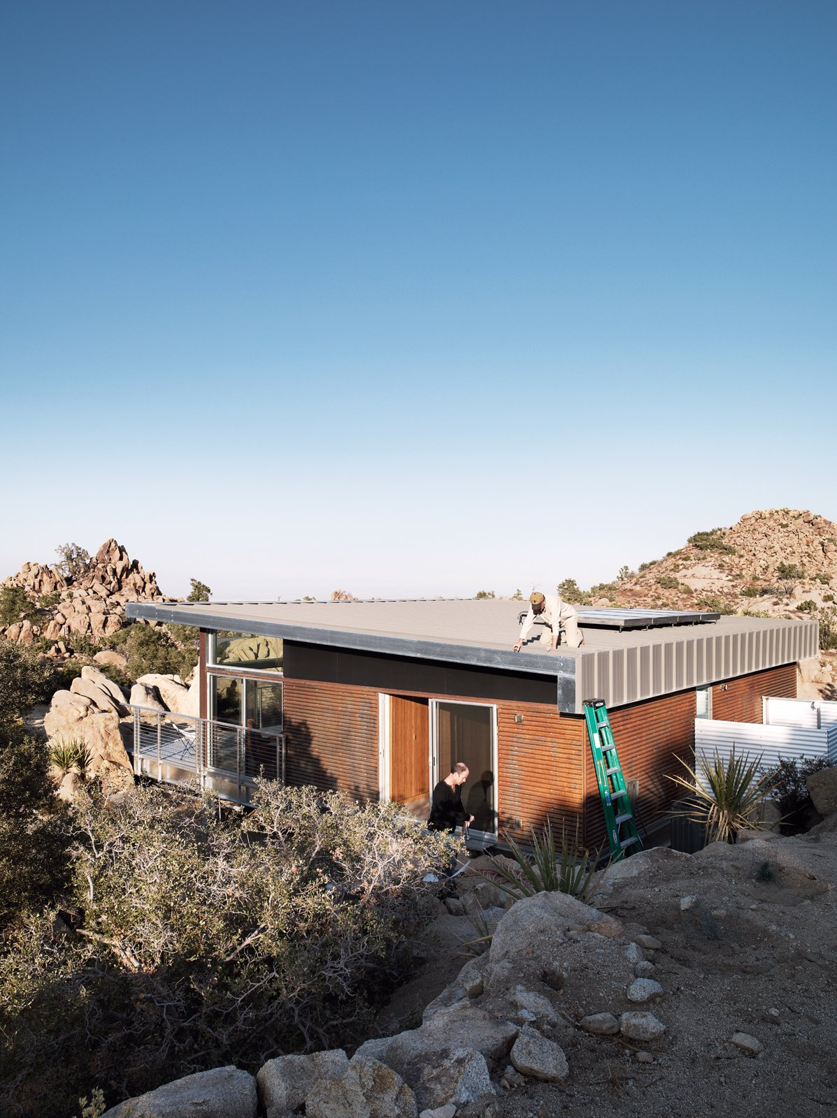"""As a paean to the old steel-mining shacks that inspired the home, McAdam sprayed the the corrugated-steel exterior with apple cider vinegar to create a warm rust effect. Small """"Hybrid Prefab"""" Home in the Desert - Photo 9 of 10"""