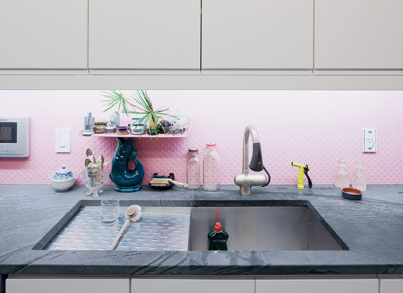 A garden path in the backyard was paved with discarded marble windowsills and stone doorframes. This reuse of ruins adds texture to the landscape. Tagged: Kitchen, White Cabinet, and Marble Counter.  Photo 9 of 15 in How to Design with Pink from Village People