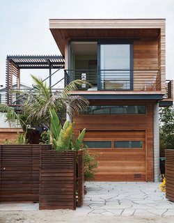 A Modern Coastal Home in Stinson Beach - Photo 1 of 10 - On a sandy cul-de-sac in Stinson Beach, California, architects Matthew Peek and Renata Ancona built an elevated modern structure beside a modest 1940s bungalow.
