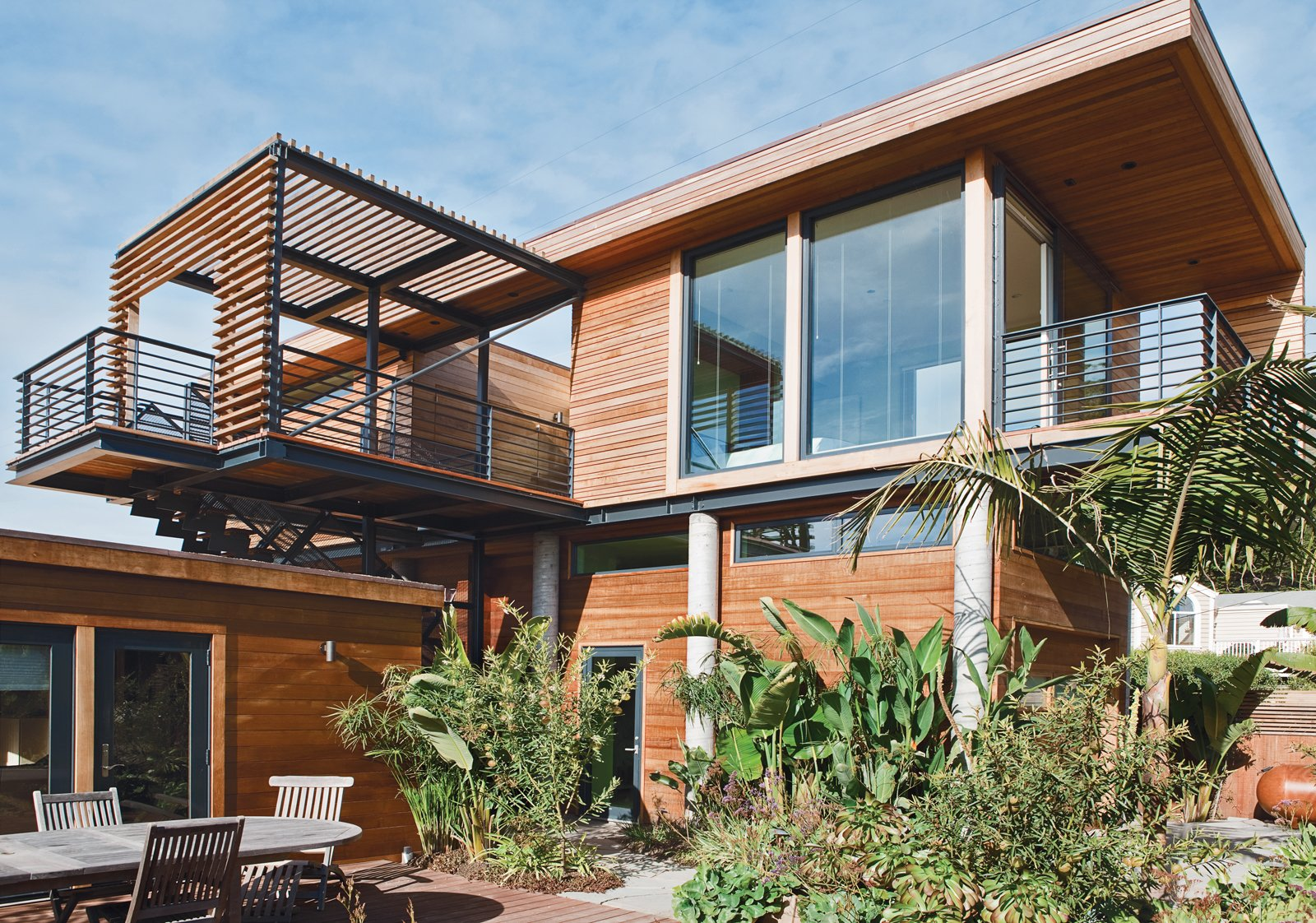 The cantilevered entry court assists with the reinforcement by securing the building's weight seaward.  Photo 9 of 10 in A Modern Coastal Home in Stinson Beach