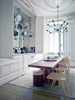 The Single Octopus chandelier, designed by Autoban, hangs in the kitchen of Çağlar's Istanbul apartment.
