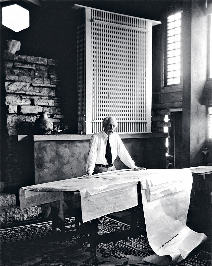 """When I set up this shot of Wright in his studio at Taliesin, he hadn't shaved that morning and told me he wasn't about to. So I had to move the camera back to conceal the stubble, which actually improved the shot."" Behind Wright is a model of the San Francisco Call building, a favorite of his that was never built.  Photo 5 of 8 in An Interview With Frank Lloyd Wright's Photographer Pedro E. Guerrero from Pedro E. Guerrero"