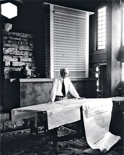 "An Interview With Frank Lloyd Wright's Photographer Pedro E. Guerrero - Photo 5 of 8 - ""When I set up this shot of Wright in his studio at Taliesin, he hadn't shaved that morning and told me he wasn't about to. So I had to move the camera back to conceal the stubble, which actually improved the shot."" Behind Wright is a model of the San Francisco Call building, a favorite of his that was never built."