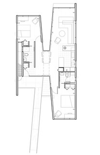 "The architect designed the building in an X formation, with two main modular structures united by a passageway. The living and sleeping areas were placed at opposite ends of the space to allow for privacy and ""to allow the children to continue their autonomous relationship with their parents on their way to self-reliance,"" he notes."