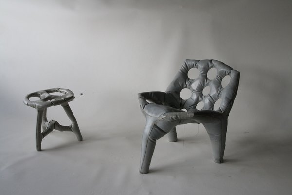 A chair and stool made of poured concrete by Tejo Remy and Rene Veenhuizen, on display in the Hands On exhibition in Washington DC.
