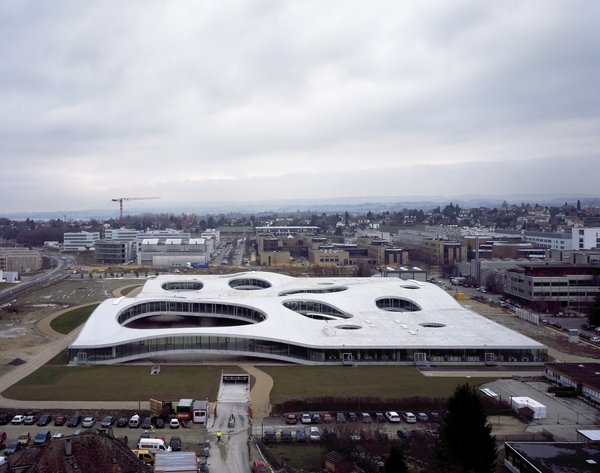 Here is the undulating, topographical form of the Rolex Learning Center in Lausanne, Switzerland. The building opened in 2009 and is the latest addition to the Ecole Polytechnique Federale de Lausanne.