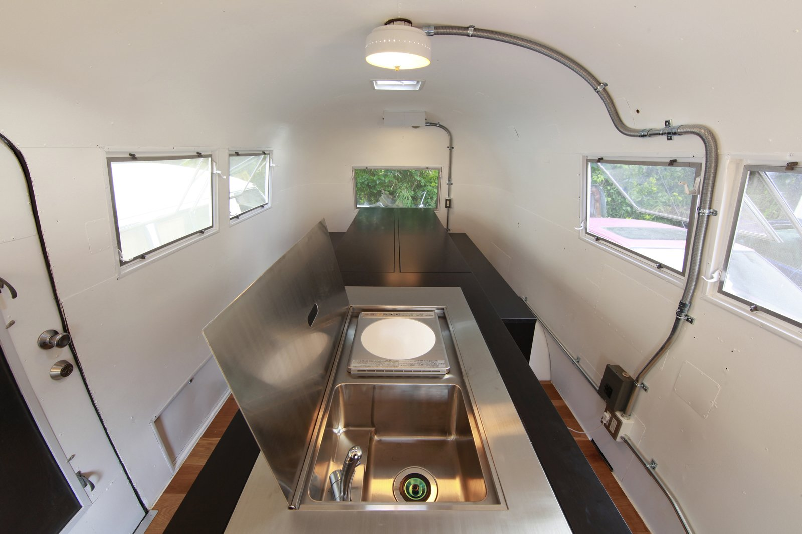 The steel lid opens up at one end of the island to reveal a sink and hot plate for cooking a meal. Photo by Sadamu Saito.  Photo 2 of 10 in Hide and Sleep