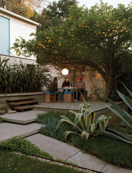 Surrounded by flax, agaves, and a prolific lemon tree, the gravel terrace out front makes an inviting place to eat, work, or party. Molina and Turin fashioned the table from repurposed glass and Unistrut tube steel and the humble chairs from plywood wrapped in sheets of blue foam.