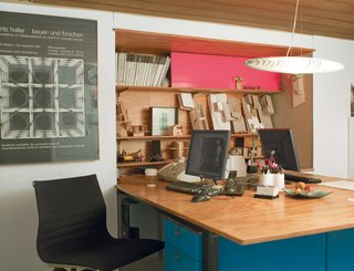 How Good Idea Studio Revamped a 1924 Clapboard House on a $62,000 Budget - Photo 5 of 11 - The architectural office below the living quarters is compact, with just enough space for shared workstations and a bookcase made of plywood and pink Plexiglas.