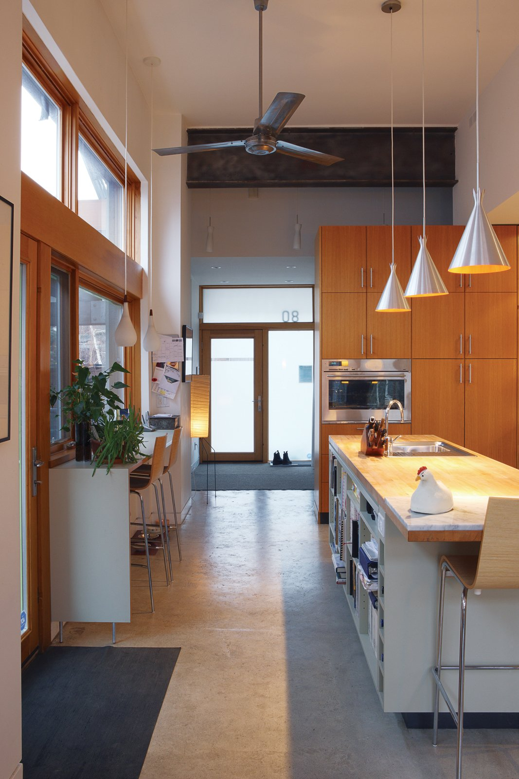 The kitchen, which gets light from three sides, welcomes guests into the house.