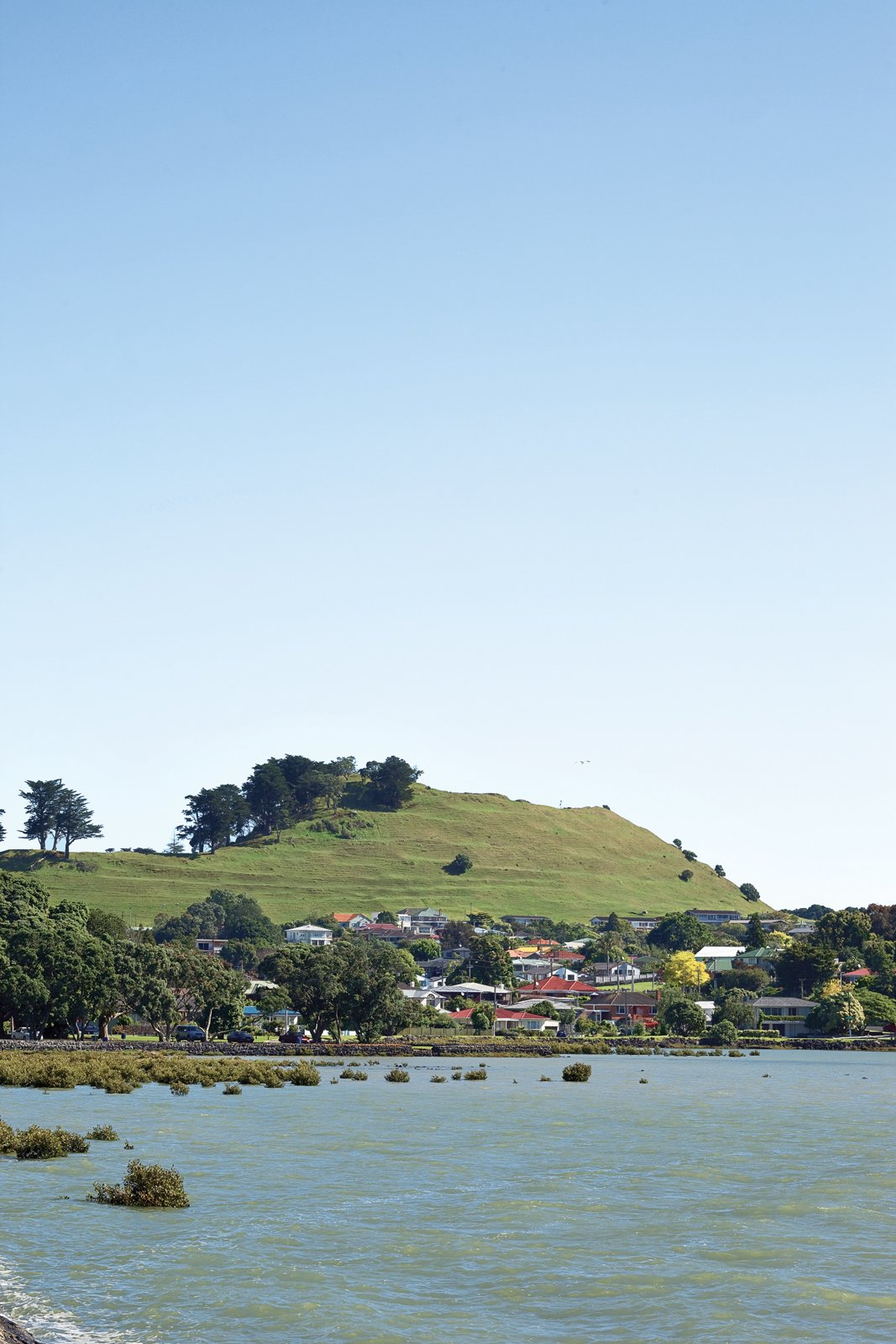 Auckland's Mangere Mountain is a dormant volcano that rises above the shore of the Manukau Harbor. It was once a site of strategic importance to early Maori tribes, and development is now prohibited on its cone. The Great Compression - Photo 1 of 11