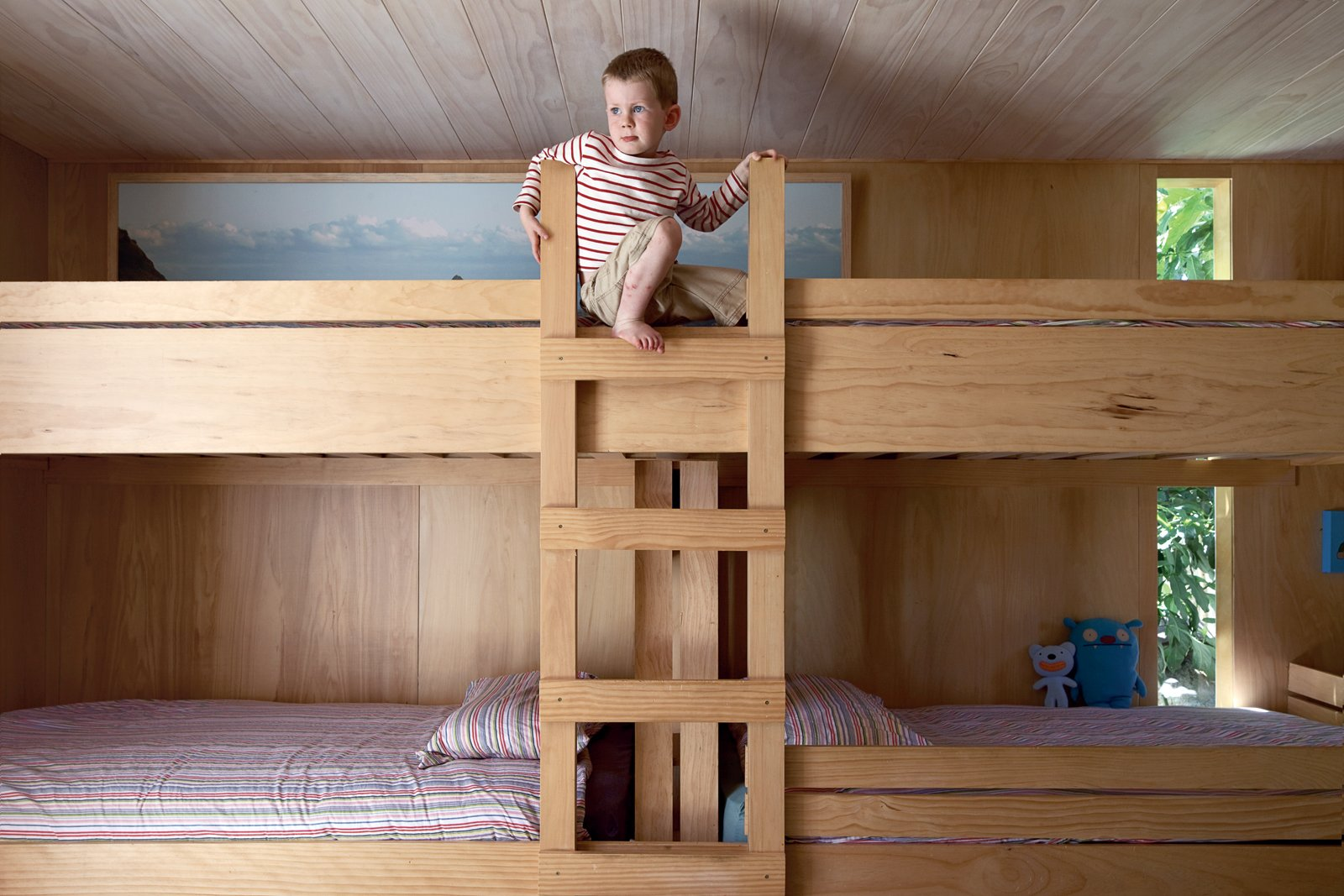 In the kids' room, Seamus climbs the bunk beds he shares with his siblings. Tagged: Kids Room, Bedroom, and Bunks.  Photo 10 of 11 in The Great Compression