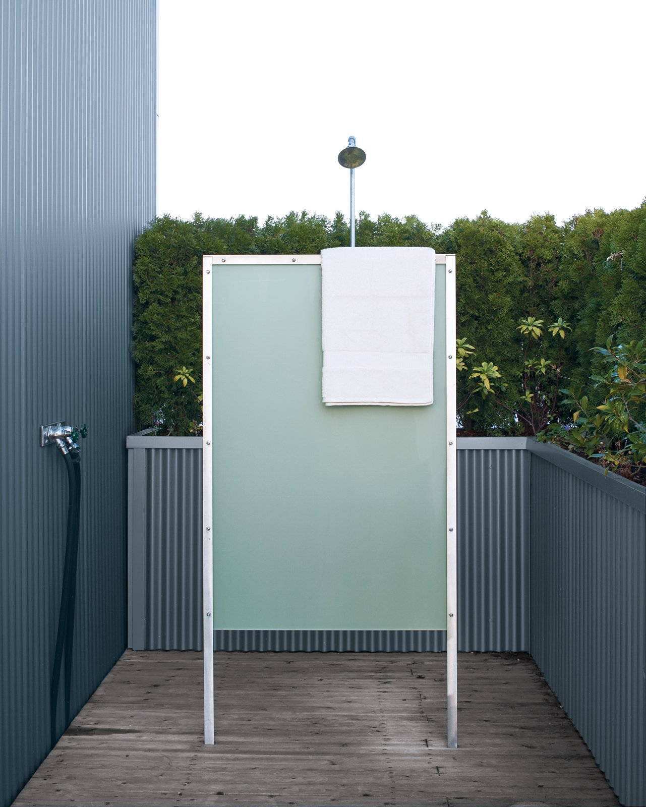 The home's exterior fittings, like the outdoor shower, offer modern comforts.  Photo 5 of 10 in Sky Small