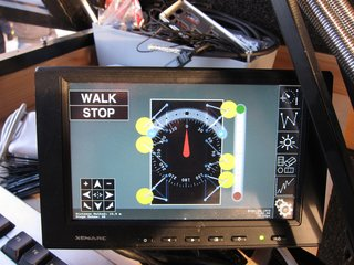 A Nomadic Future for the Walking House - Photo 5 of 8 - Created with the use of Processing, this is the touchscreen interface with which you can independently control the position of each leg.  As you can see, you can tell it which direction you want it to walk, and how much to turn left or right (with three legs on the ground at all times for stability, moving at a maximum speed of 60 meters per hour).