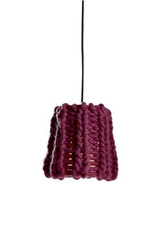 Milan 2010 in Color - Photo 5 of 12 - There were actually a handful of yarn lampshades at the fair—the others I saw were from Mut and Ana Krâs at the Salone Satellite—which, as a novice knitter and fan-of-craft, I loved. Granny, a chunky burgundy pendant by Pudelkern Design for Casamania, was inspired by cold winters in the Alps, and made from fire retardant wool.