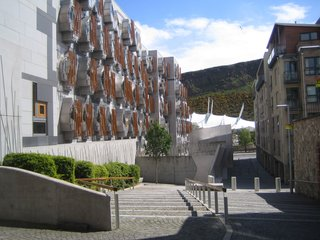 Scotland: Day 2 - Photo 6 of 11 - From Reid Close I got a great view of the back of the Scottish Parliament building and the craggy Arthur's Seat. The MPs's Thinkpods can be seen on the exterior of the Parliament.