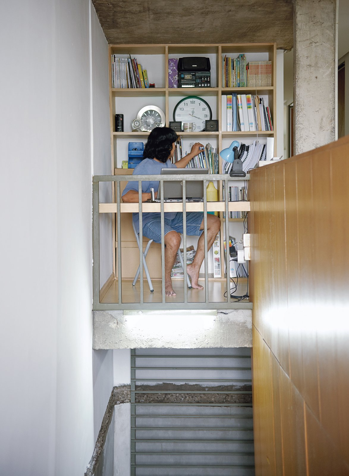 Maximizing space is crucial in this densely populated city, and Djuhara put every last interior cubic inch to good use in his design, as Wisnu's work nook attests.  Photo 4 of 26 in Humid City, Cool Home