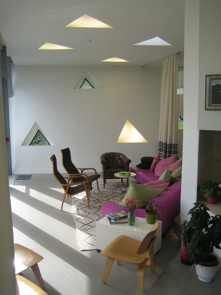 Here you can see the triangle motif from the exterior moved inside into the living room style space. Though many of the triangles are in fact windows punched into the envelope of the building, many others are actually lights. There's plenty of natural daylight from the massive glazed window on to the terrace, though.