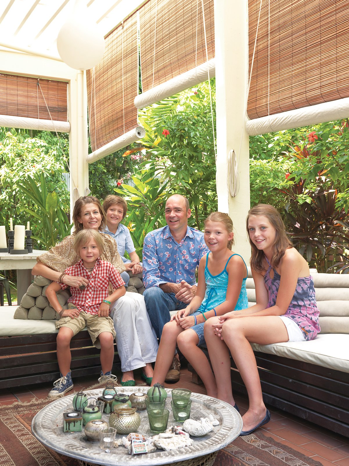The family—–Wieger, Nicolette, Tammo, Joost, Teuntje, and Pip—–eats most of their meals on the lush, sunlit terrace off the main floor.  Photo 5 of 11 in A Family Moves from Netherlands to Singapore