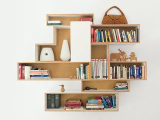 A Family Moves from Netherlands to Singapore - Photo 6 of 11 - The house lacked significant storage space when the family moved in, so De Waart designed bookcases to custom-fit their favorite display items.