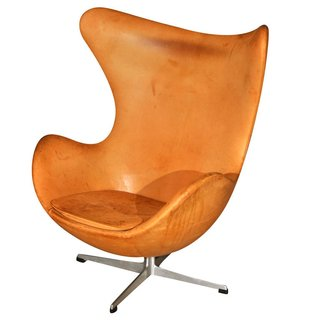 An early-edition Egg Chair, circa 1970, with original leather. By Arne Jacobsen.