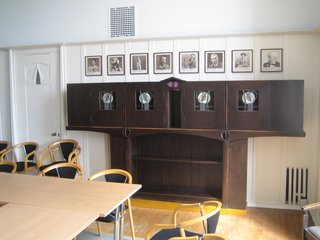 Scotland: Day 4 - Photo 4 of 11 - This hutch is simply too beautiful. The row of photos above charts famous alumnus and administrators at the Glasgow School of Art. Mackintosh (who attended as an architecture student) leads the pack.