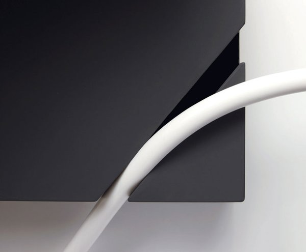 A perfectly spaced notch in the base of the lamp holds the cord in place, allowing the lamp's user to achieve a harmonious placement of fixture and flower.