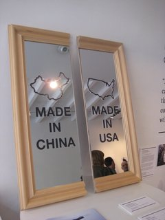 Uncomfortable Conversations - Photo 3 of 7 - Chi-Merica by Paul Loebach. This mirror represents the divide between American-made products and those produced in China.
