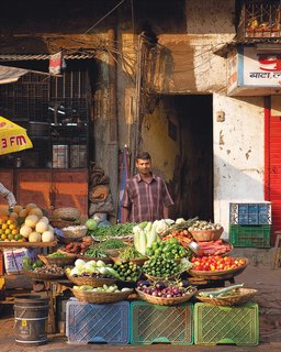 Mumbai, India - Photo 1 of 12 - A streetside vegetable purveyor shows his offerings.