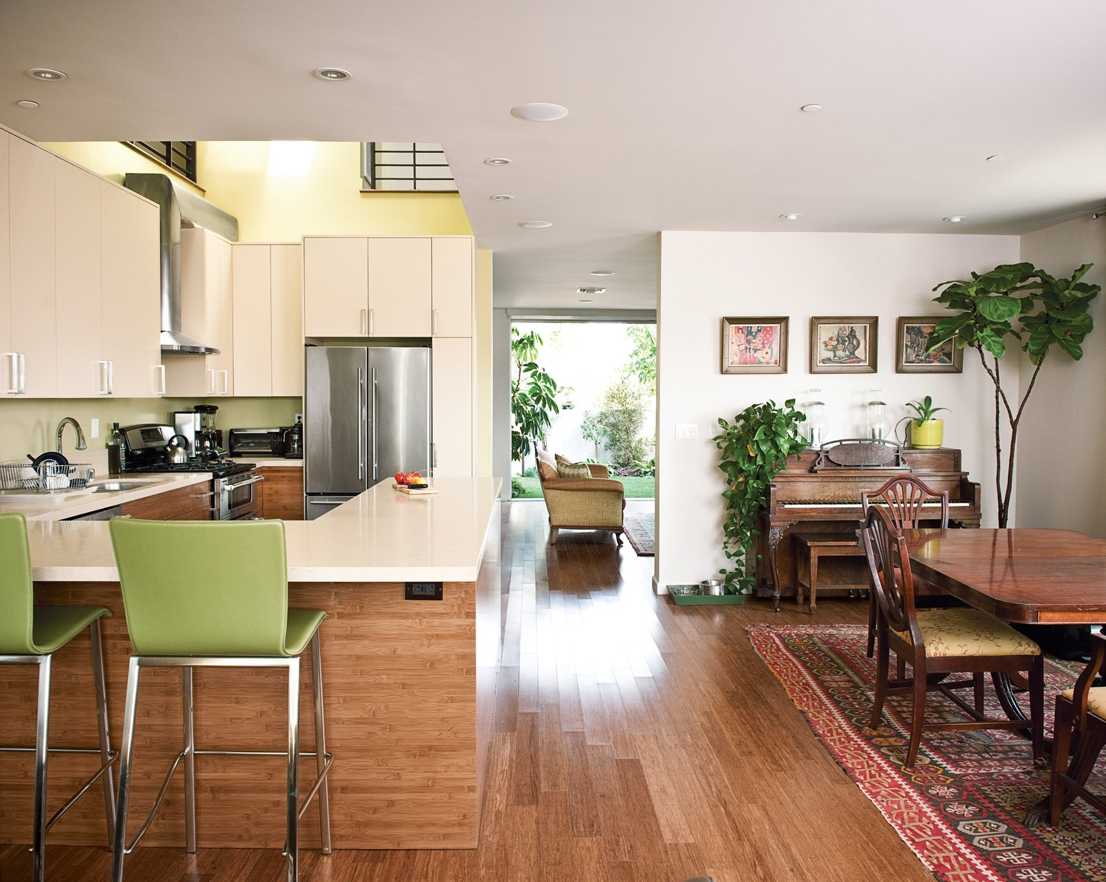 Developer Michael Kyle and his wife Joanne Higgins mix old and new in their living and kitchen areas.